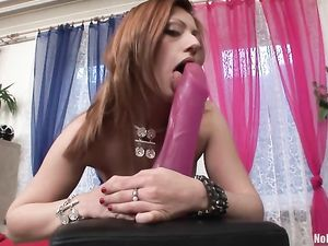 Stripping Slut Sits Her Snatch On A Huge Dildo