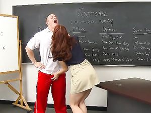 Redhead Fucks The Football Coach In Class
